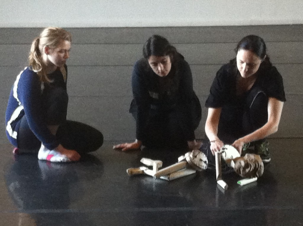 Another still from Tom's workshop... learning how to make the puppet sleep. Gail (center) with students Dorothy and Caty.