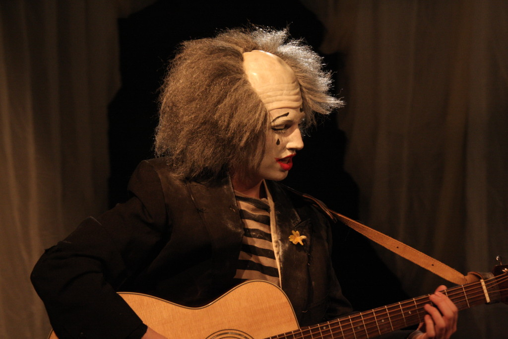 Hogue— masked as a Big Tent Pierrot—plays one of her original compositions.